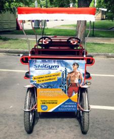 Реклама на веломобиле