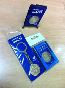 Дизайн упаковки сувенирных монет и брелков