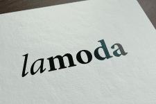 Lamoda.ru - Лого интернет-магазина одежды и обуви