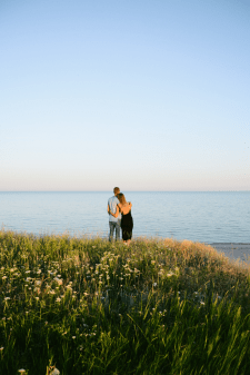 beautiful couple stands on a hill