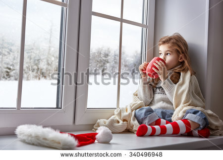 stock-photo-little-girl-sitting-by-the-window-with-a-cup-of-hot-drink-and-looking-at-the-winter-forest-340496948.jpg